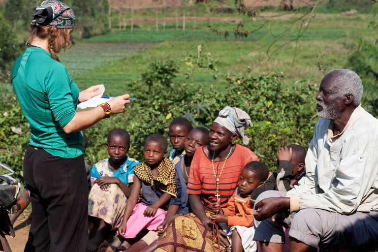 Humanitarian aid volunteer talking to villagers about malaria prevention. Kashakeracell, Western, Uganda, East Africa, Africa