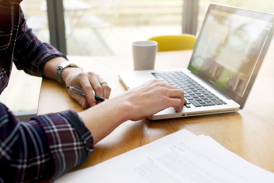 A man uses a laptop computer.