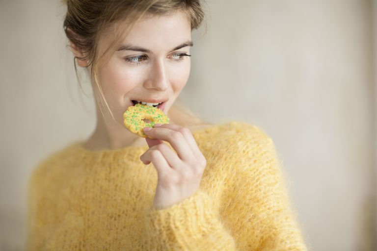 Woman eating a holiday cookie