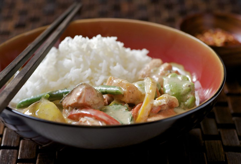 Thai Curry with Fish, Vegetables and Rice in Red Bowl