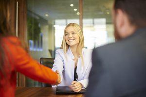 Intern shaking hands with interviewer