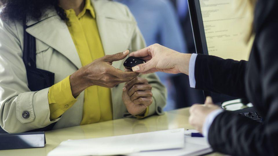 Close up of rental car key exchange
