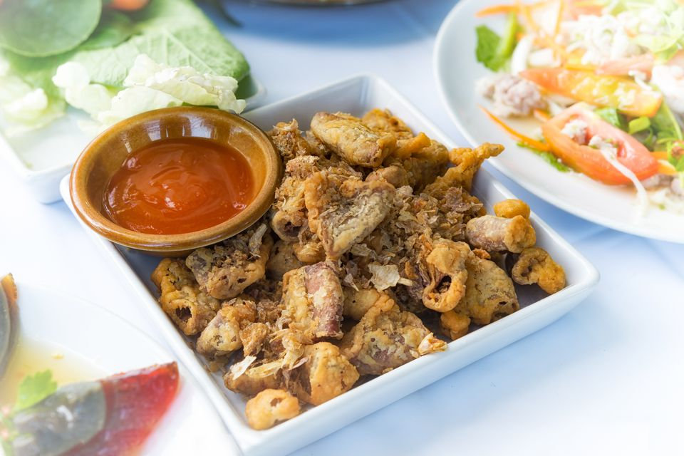 Chitterlings Fried garlic on white table, thai style