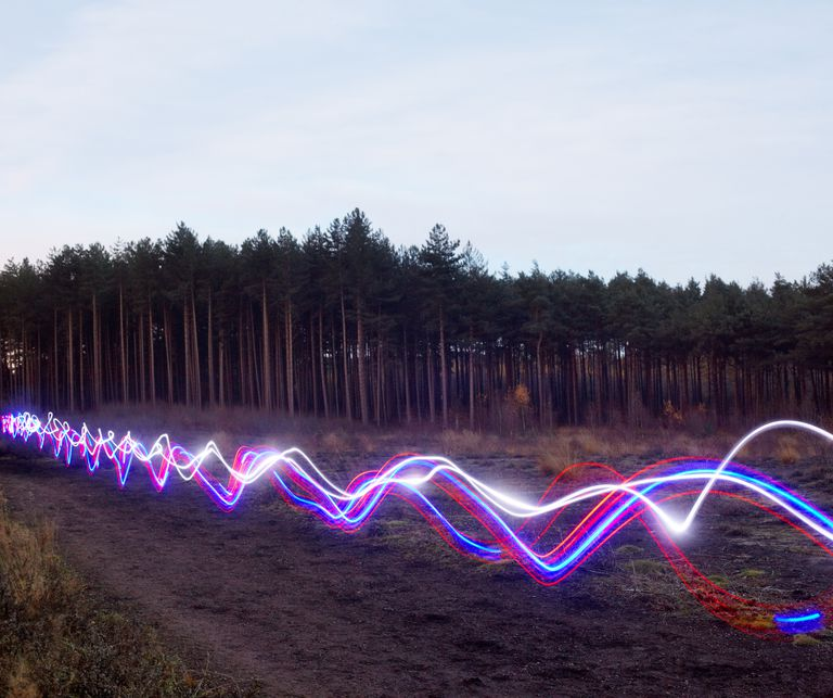 Red, blue and white light trails on heath.
