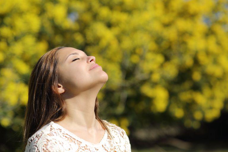 woman taking deep breath of air