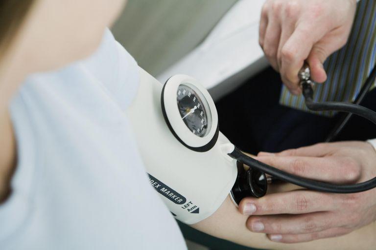 Woman wearing blood pressure gauge