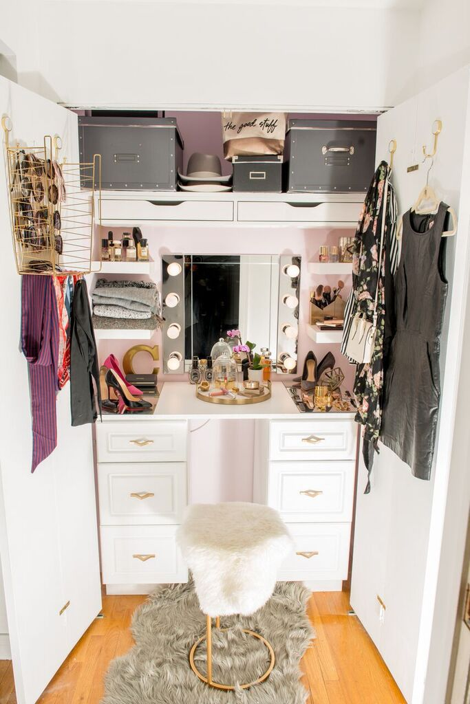 Closet with a chair and vanity