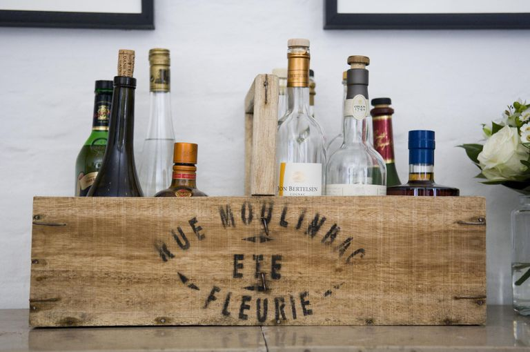 Bottles with liquor in a wood box on a table