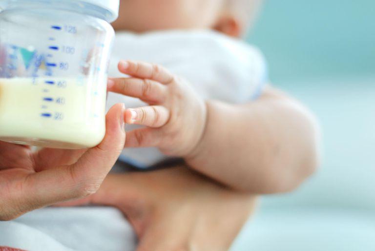 Mother holding milk bottle