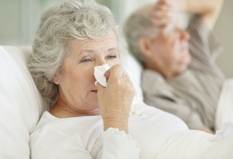 Senior couple in bed with the flu