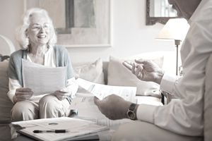 Senior couple discussing whether to donate some of their IRA savings to charity.