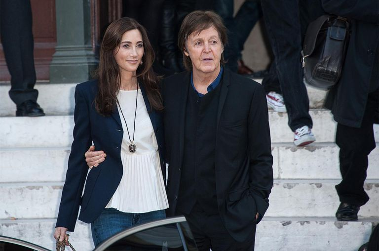 Sir Paul McCartney (R) and Nancy Shevell arrive at the Stella McCartney Spring / Summer 2013 show as part of Paris Fashion Week