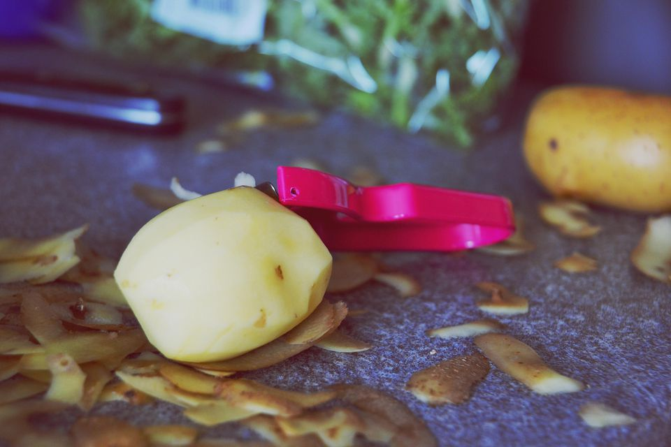 Close-Up Of Peeled Potato On Table