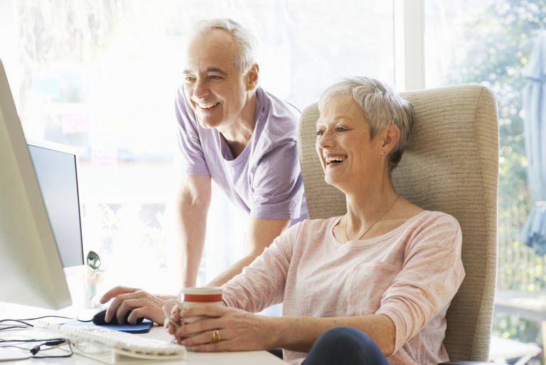 retired couple using computer