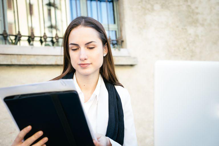 Businesswoman Reading Reports