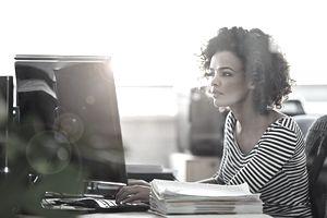 woman at computer with manual