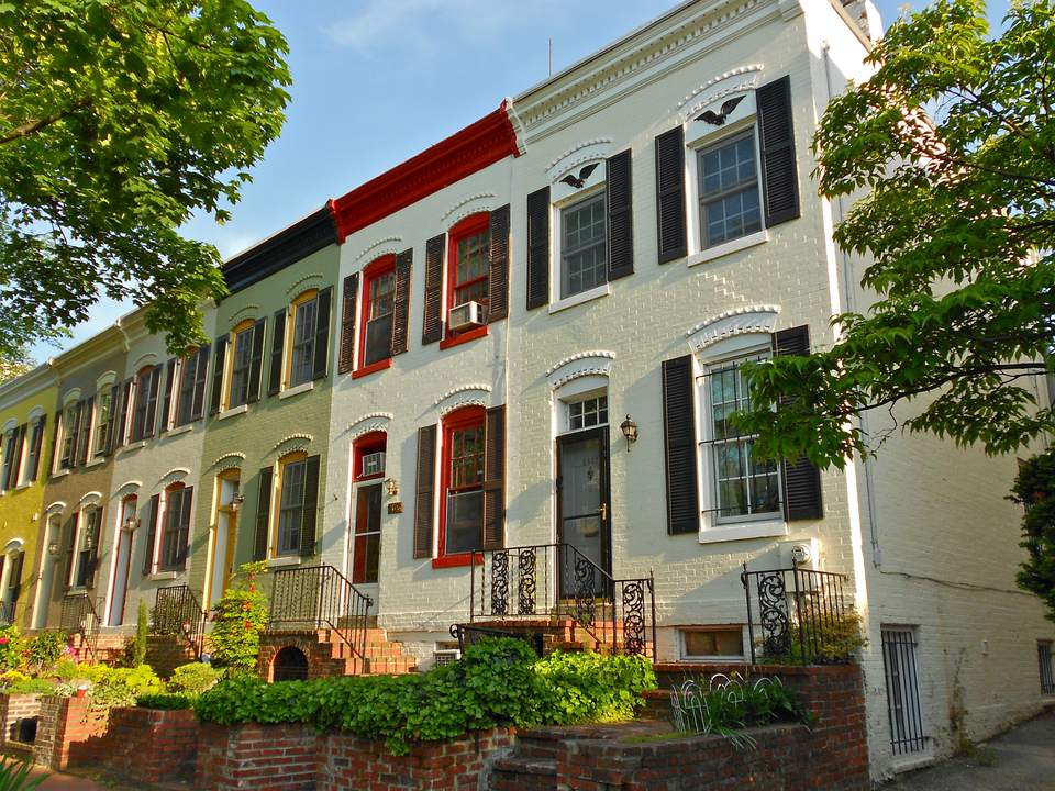 Painted brick row houses in the Foggy Bottom Historic District of Washington DC.