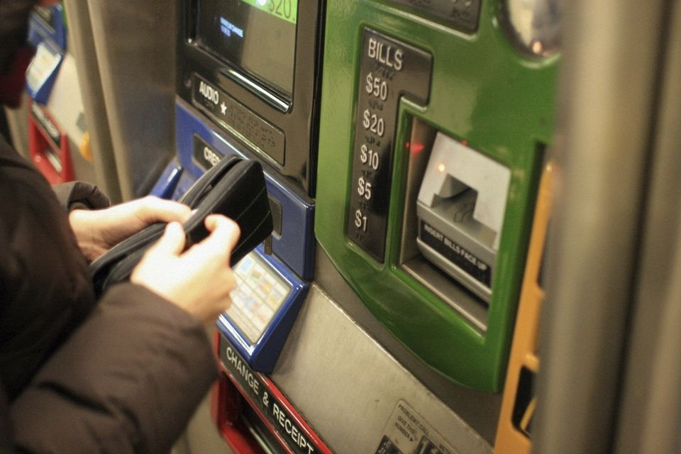 Woman Buying Metrocard
