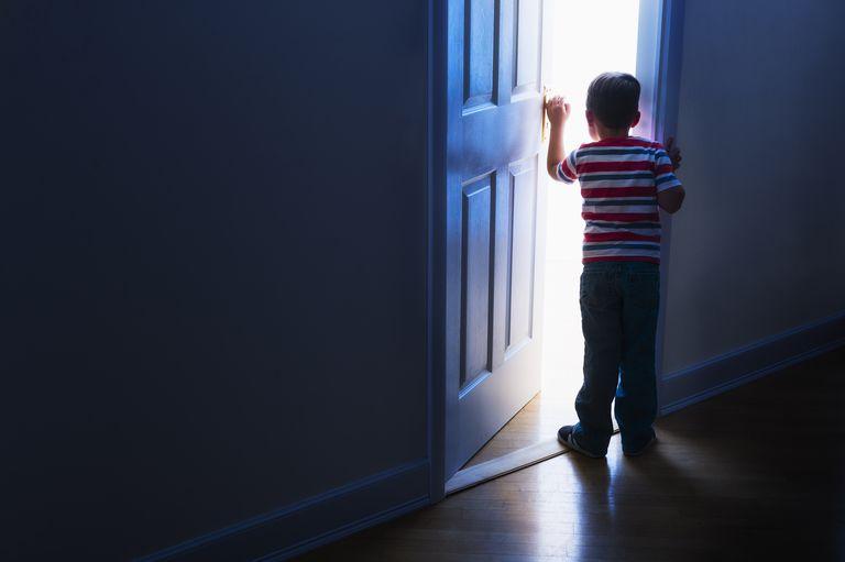 Boy walks out door