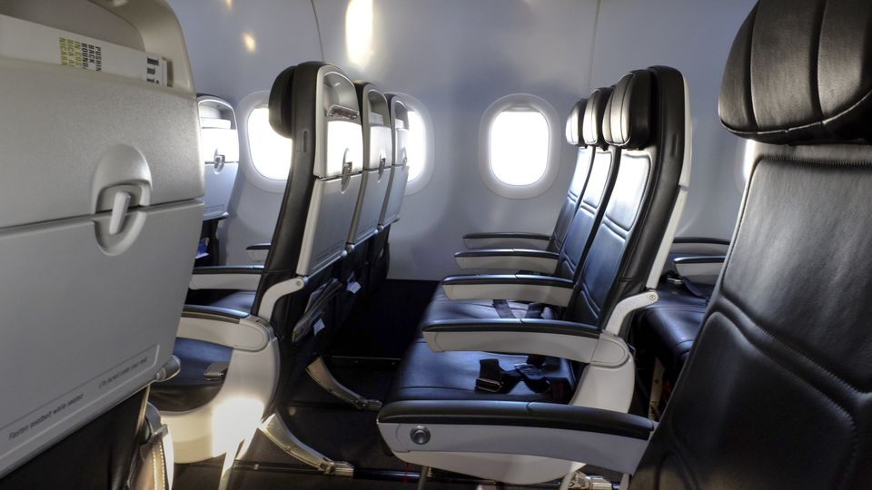 Black leather airplane seats in row