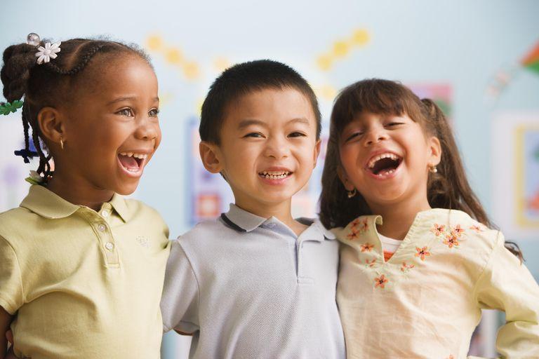 Schoolchildren (4-5) smiling, close-up after a compliment