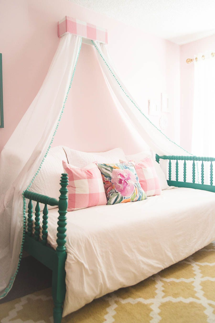 Girls room with canopy bed featuring a DIY cornice canopy