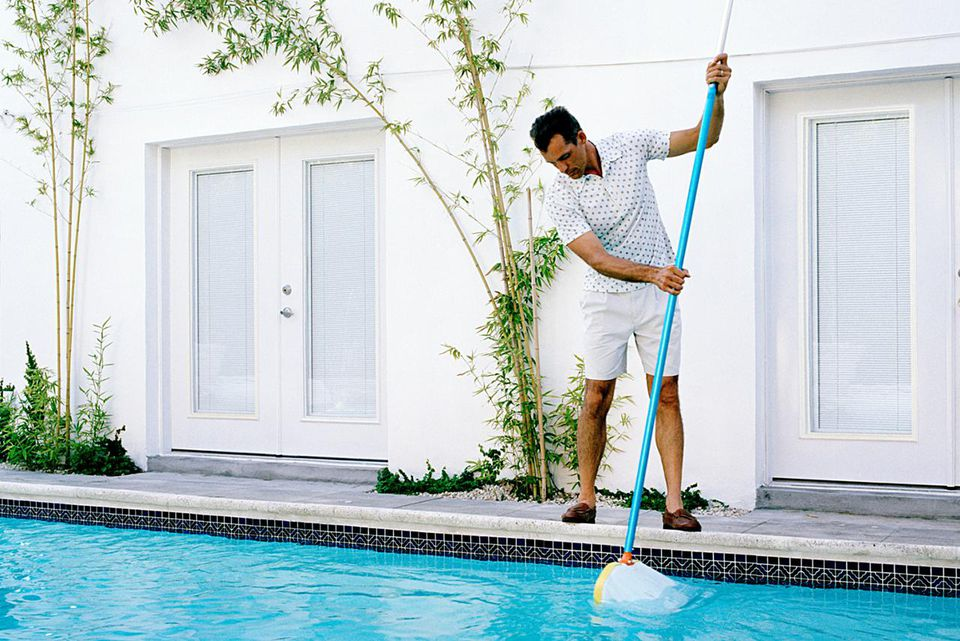 guy cleaning pool