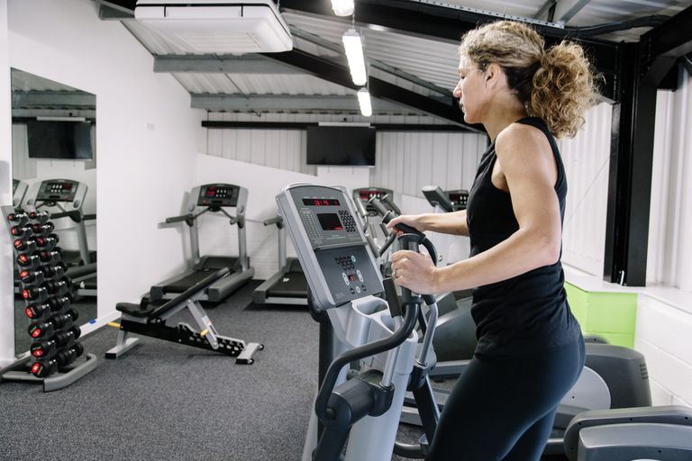 Woman on an elliptical trainer