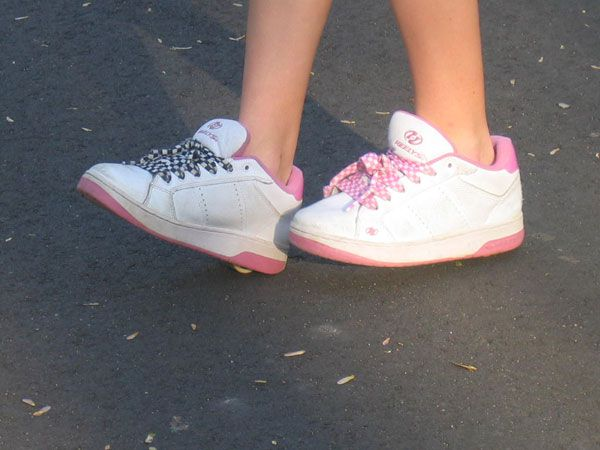 A child using their Heelys in skate mode.
