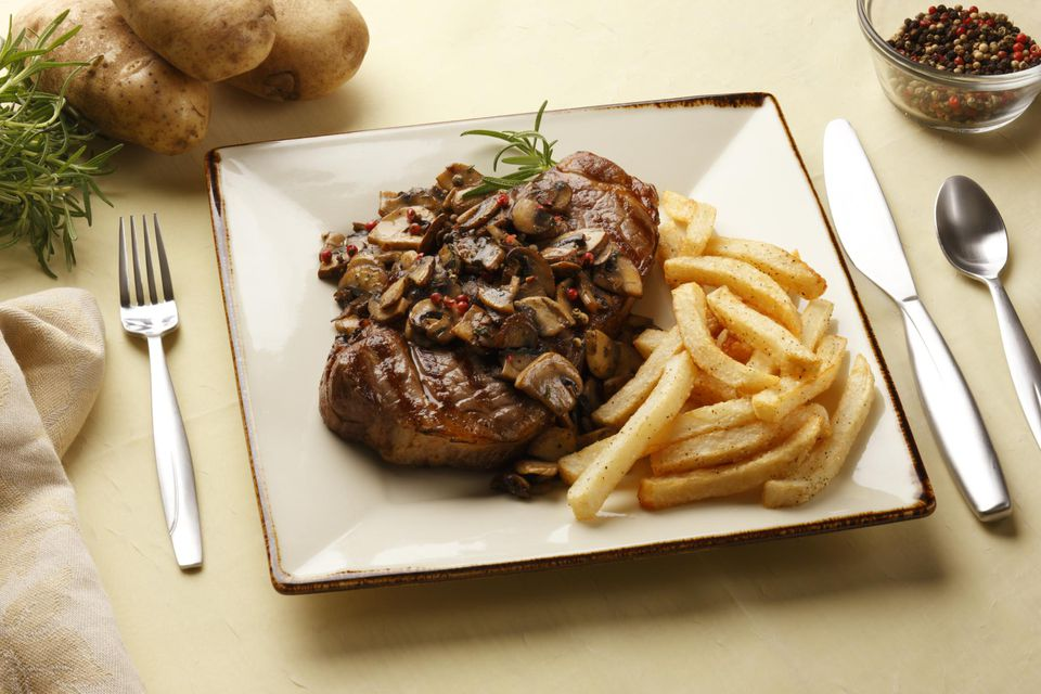 Rib-eye steak smothered in mushrooms sauteed in sherry and butter with crispy french fries.