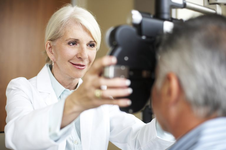 An optometrist examines a patient