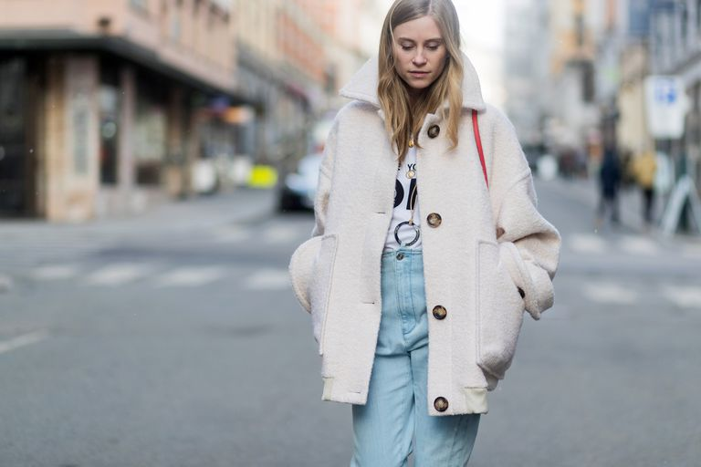 Street style woman in jeans and coat