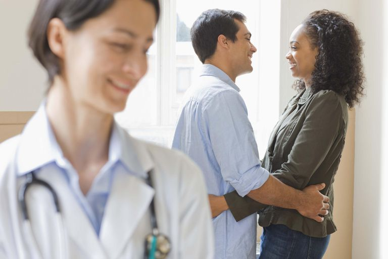 Doctor with embracing couple