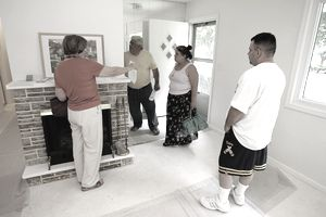 A family looking at a home with a realtor.