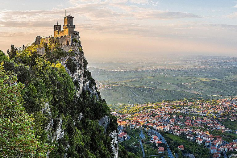 La Rocca tower in the foreground is the oldest of three guard towers that overlook the city and independent country of San Marino.