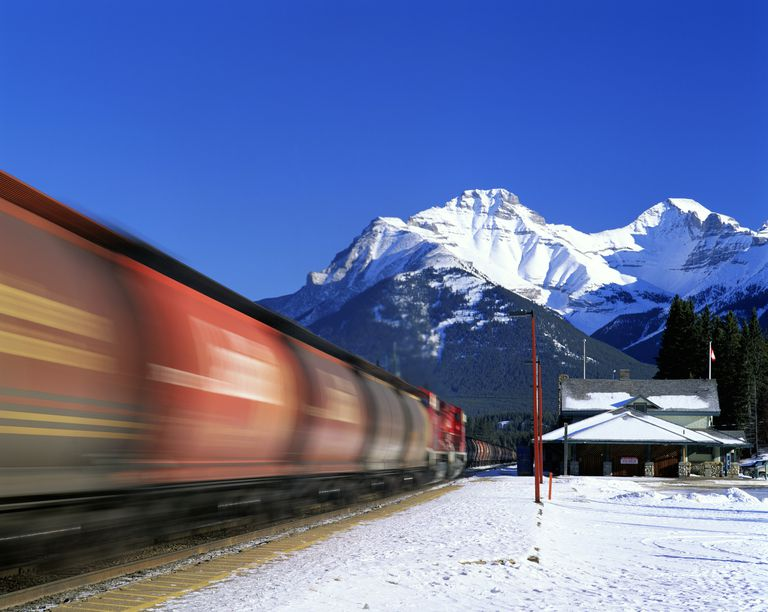 Train Speeding Past Railroad Station in Banff, Canada