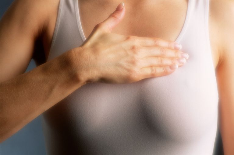 woman examining breast that has become itchy
