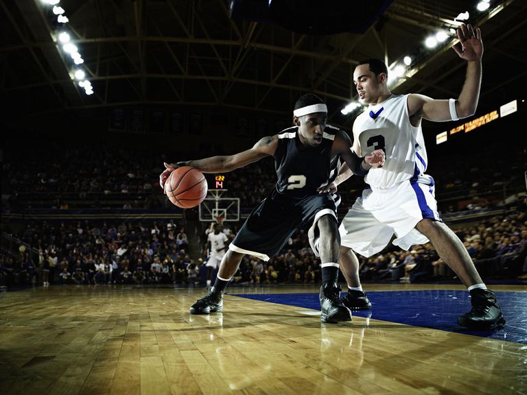 Basketball player being guarded by defender