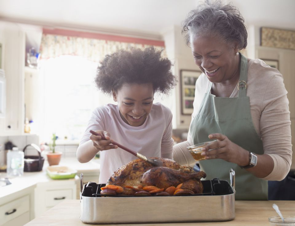 Two generations of women cooking together in kitchen