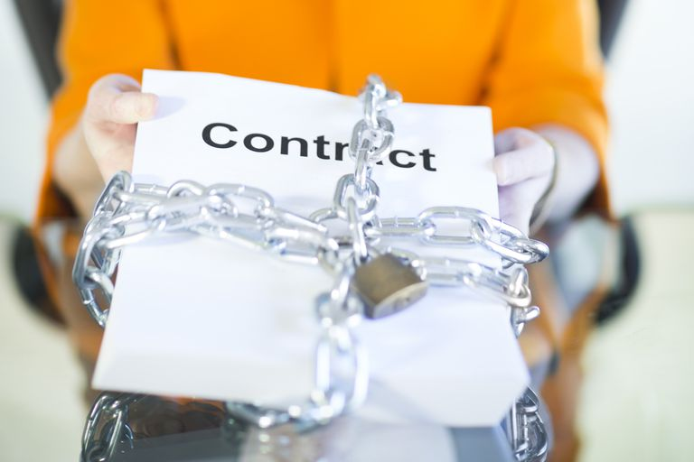A photo of a contract with a lock and chain around it.