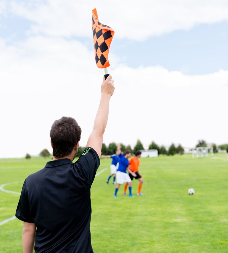 Football referee pointing a fault