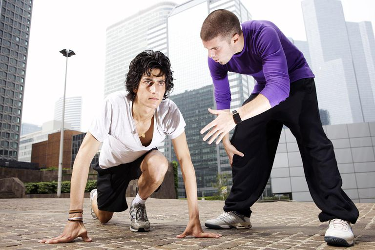 Runner and personal trainer in urban city