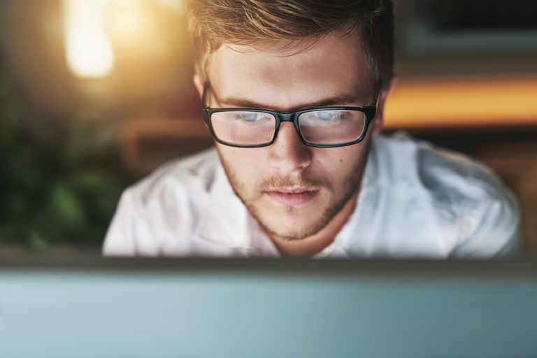 Closeup of man looking at computer