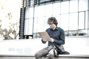 Man looking at clipboard