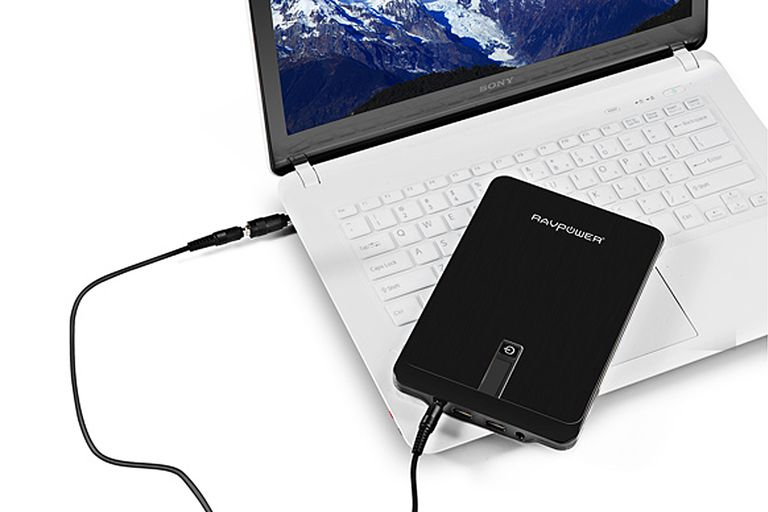 Picture of a laptop charging via a portable battery pack