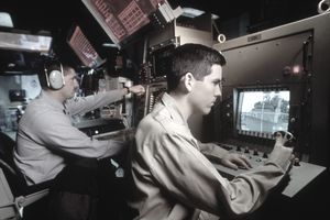 workers in naval communications at computers