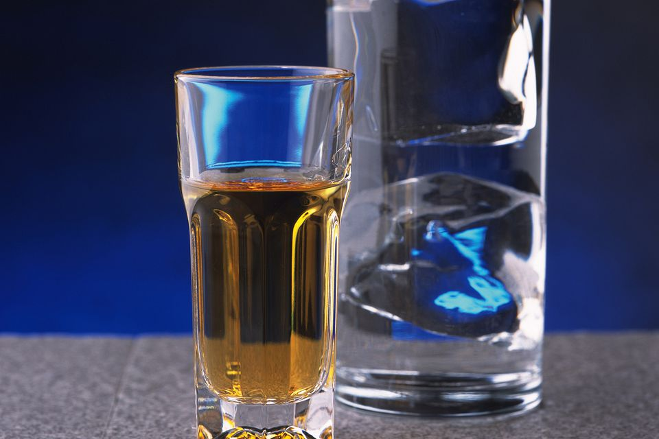 Glass of whiskey with a water back.
