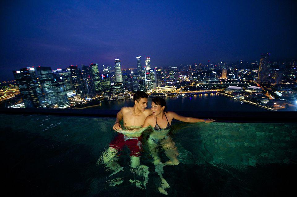 Couple enjoying Skypark swimming pool at Marina Bay Sands
