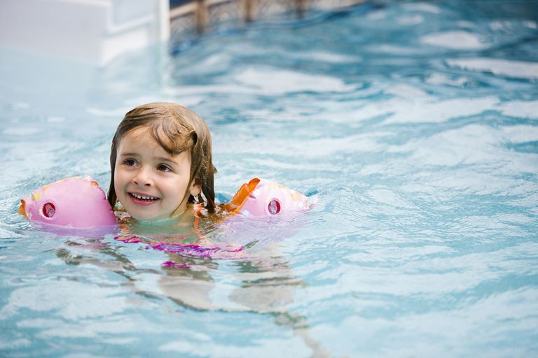 Girl in swimming pool, Mount Albert, Ontario