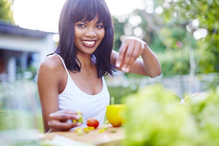 woman making a salad